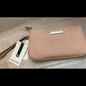Blush/pink NWT Nine West wristlet.